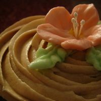 Dsc03208.jpg chocolate cupcake with chocolate buttercream icing...royal icing flower