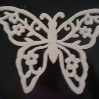 White Modeling Chocolate Butterfly If you are interested how I made this, there is a tutorial on make your own mold in the forum right here on CC http://cakecentral.com/cake-...