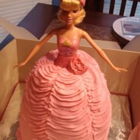 Princess Cake Princess cake with a real Barbie. Chocolate cake with pink buttercream frosting.