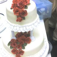 Class 3 Final Cake This was my final cake for Wilton's Course 3. It was the first time using that kind of tiers, fondant roses and that border. I was...