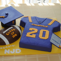 Graduation Cake For A Football Player I made this cake for my daughters boyfriends Graduation party. He played football and it was very important to him.