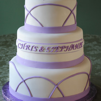 Simple White & Purple Wedding Cake All covered in Fondant with Fondant decorations. The client had no idea what she wanted and we came up with this after seeing a cake here...