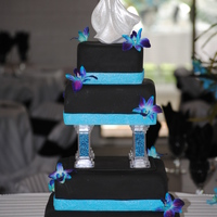 Black Square Wedding Cake Made this for a friends daughter who wanted a black cake. It turned out to look good with the wedding colors.