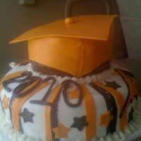 High School Graduation Cake Fondant covered cake with fondant accents. The cap was fondant also