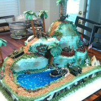 Army Men Cake This is a multi-layer cake that a friend (hollylikescake) and I made. It is covered in buttercream and airbrushed. The water is made with...