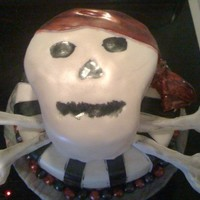 Skull/pirate Fondant covered cake. Top layer was carved and covered with fondant to look like a skull. All color was hand painted and then airbrushed...