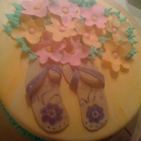 Flip Flops And Flowers Fondant coverd with fondant accents.