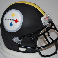 Steeler's Football Helmet This is for my nephews 10th bday. This is his favorite NFL team. All vanilla cake covered with fondant. Face mask is real because I didn&#...