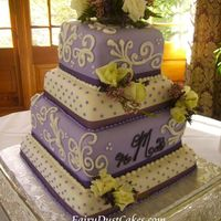 Lavender Swiss Dots And Ivory Scrolls Wedding Cake