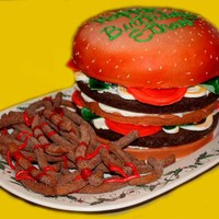 Hamburger Cake I hate the way this pic out I used all of the yellow to cover up the background lol, the cake was so cute and I had a lot of fun making it...