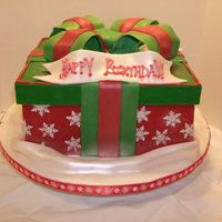 Christmas Birthday  This cake was my first paid cake. I made it for several people's December birthdays. The cake was vanilla WASC with chocolate trouffle...
