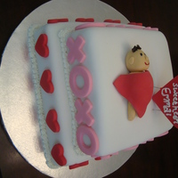 Valentine's Day Themed Baby Shower Cake   10in and 8in square cakes with fondant decorations.