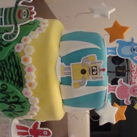 Yo Gabba Gabba Cake   8in and 6in cakes covered in fondant with fondant decorations and cake topper set.