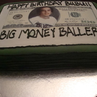 16Th Birthday Stack Of Hundred Dollar Bills Cake 9x13 cake covered with fondant with an edible image on top. For my cousin's 16th birthday!! He loved it!!