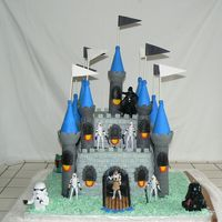 Sergio's Castle Cake My sister and I had alot of fun making this cake for my sons 7th birthday, it's covered in fondant and the base is tinted coconut.