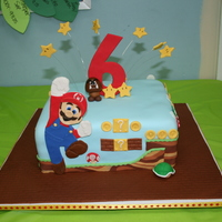 "Mario Cake 10"" sqaure, covered in fondant. Inspired by several CC cakes, mostly jaklotz1. And thanks to CakeMommyTX for posting instruction on..."