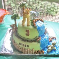 Zoo Cake For a zoo birthday party. I had so much fun making this one. Bamboo fence is packaged cookies, water is piping gel, palm trees are fondant...