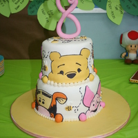 "Pooh Bear cakes are 8"" and 6"", covered in fondant. Faces are made of fondant with black royal icing outlines"