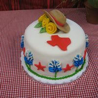Texas Theme Cake This was for teacher appreciation luncheon. Theme was go texan. Bluebonnets are buttercream, hat is half fondant, half gum paste,...