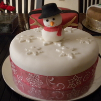 Snowman Cake This is a cake for fund raising. I made 3 of them. It's simple so it didn't take long!