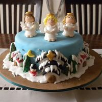 Snowy Town With Angels Singing Christmas Carols Charity cake for St Jude Charity, my very last cake in 2009. Wish I knew the Cake Decorator Association Competition a bit earlier as I...
