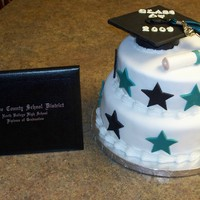 High School Graduation Cake 2009  This was for my son and his friend's high school graduation party. Unfortunately I didn't have much time to prepare, so this was...