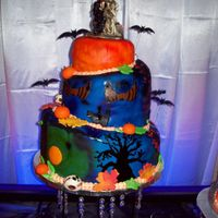 Halloween Wedding Cake my first whimsical cake. top and bottom tier golden yellow cake with buttercream filling and middle tier spice cake with cream cheese...