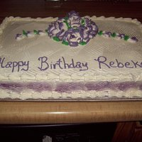 Rebekah's Birthday golden yellow cake with raspberry filling and white buttercream icing. Violet two tone roses.