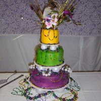 Mardi Gras Wedding Cake This was done for my sons mother in law. They were married on Fat Tuesday 2005. It was a wild wedding and an event wilder reception. The...