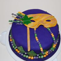 Mardi Gras Cake This was a cake for a final in a fondant class I took. It is an almond cake with bavarian filling. It is covered in fondant and all...