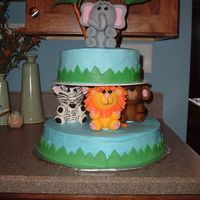 Amazing Amazon A Wilton design that earned me lots of compliments at the baby shower. For my first tiered cake, my first fondant, and well...most of my...