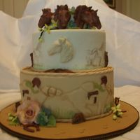 State Fair Entry - Horse Theme This is a dummy cake for the state fair. pastillage horse heads, gumpaste flowers., fondant covered