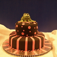 Frog Cake Black fondant, hot pink fondant accents, gumpaste frog. all at client's request. We don't know how the frog fits in but it did...