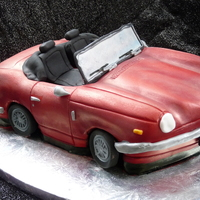 3D Triumph Spitfire I made this for my dad's 60th birthday last week... he has bought himself a Triumph Spitfire thats in pieces to restore so this cake...
