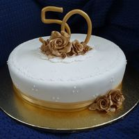 50Th Wedding Anniversary I was so proud of my monogram that i made myself. I first of all painted it with antique gold cake paint but wasnt right didnt match the...