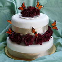 50Th Anniversary Monarch Cake this was done for a couple celebrating their 50th anniversary. He loves roses she loves butterflies. the butterflies were supplied and are...