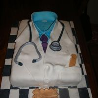Dr Heidegger Farewell Cake Doctor theme cake with stethescope. Everything on cake is edible. Chocolate!!!!