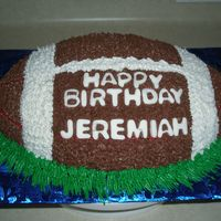 Football Cake   Football cake is covered in buttercream frosting the letters are cut out of fondant.