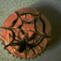 Spiderweb Cupcakes Made in 2008 for my son's Halloween Party at Preschool. Yellow cake, orange buttercream, black piping gel, and a platic spider ring.