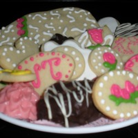 Tea And Cookies  chocolate covered white chip brownie w/white choco drizzle; sugar cookie cut-outs with royal icing and cut-outs w/homemade strawberry jelly...