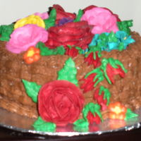 My First Cake... My first cake was a basket weave around the sides and topped with multiple flowers I learned how to make at a local confectionary shop!!...