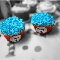 Thing 1 And Thing 2 Cupcakes Cupcakes made to match a Dr Seuss cake for first birthday. Buttercream and used the grass tip for top.