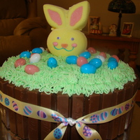 Kitkat Easter Cake 8 in chocolate layer, sides are iced in buttercream and covered with kitkats and buttercream grass, marshmallow bunny on a stick and robin...