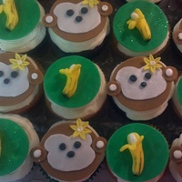 Monkey Cupcakes Vanilla cupcakes with butter cream frosting and fondant..