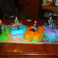 Band Members Playing Birthday Cake..  This cake was made for my boyfriends Brothers band the PDWK! The drummer Josh's birthday was last weekend and they had a show.. I made...