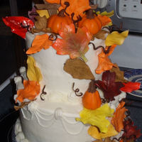 Fall Birthday Cake !   Gum paste leaves, pumpkins, and fence...Had a great time making it all! :) TFL