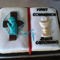 Firstcommunion3Dbiblecake.jpg Opened Bible cake covered with marshmellow fondant and decorations made with chocolate candy.