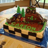 Monster Truck  I made this cake for my son's 4th birthday. Cake is covered in Chocolate Buttercream with MMF checkerboard sides and accents. Monster...