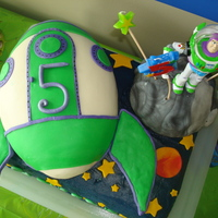 Buzz Lightyear Rocketship For my son's 5th birthday. The bday boy loved it, so I'm happy :-) Rice krispie treat moon and rocketship made from a football...