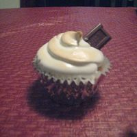 Smores Cupcake Not the best photo, SORRY! But this is a graham cracker cupcake with a spoonful of chocolate truffle and then marshmallow frosting that I...